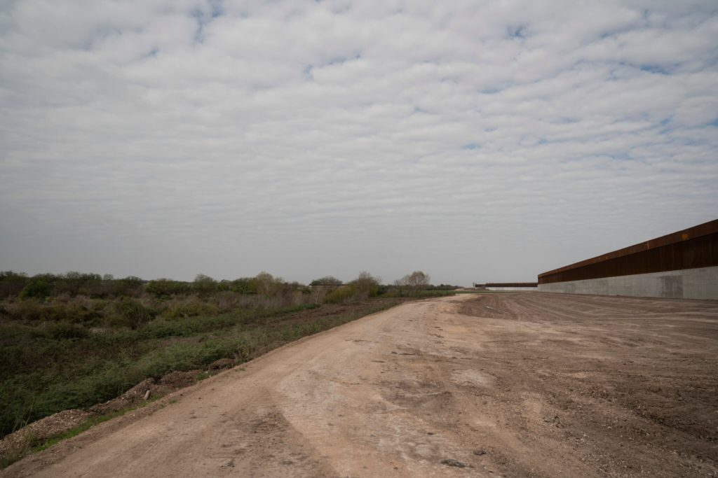 Land that was cleared up for the construction of the border wall as an enforcement zone is seen to the south side of the wall near Alamo, Texas. Credit... Verónica G. Cárdenas